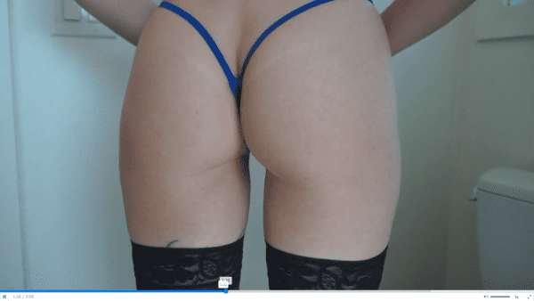 woman wearing blue g-string and black stockings for tampon fetish filming