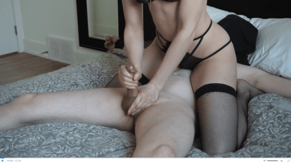 woman wearing black lingering sitting on naked man tied to bed while she teases his cock before giving him a hot ruined orgasm