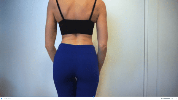 woman wearing black bra and blue yoga pants in panty try on