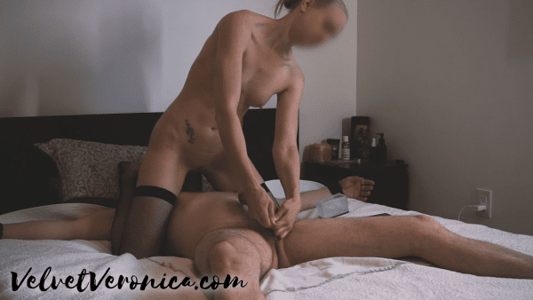 naked woman with black stockings straddling a naked man tied to a bed while she teases his cock and end in an edging session fail