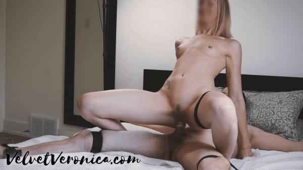 naked woman having sex with man tied to bed in reverse cowgirl position with numbing cream on cock