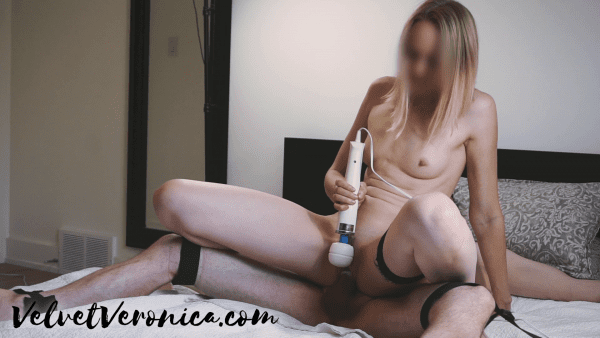naked woman having sex with man tied to bed in reverse cowgirl position using hitachi with numbing cream on cock