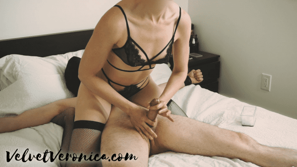 woman wearing black lingerie sitting on top of a naked man cock teasing before giving a prostate massage