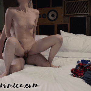 naked woman fucking a naked man in a femdom sex position where he is on his knees laying back and she's sitting on him reverse cowgirl