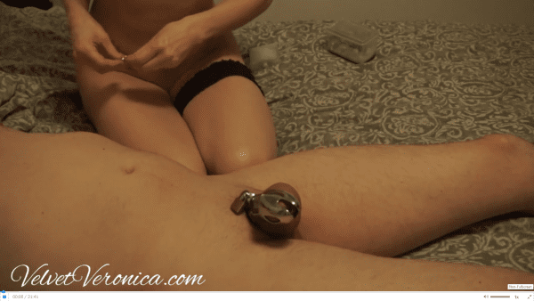naked woman sitting beside naked man in chastity before edging and denial