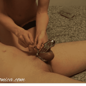 naked woman sitting beside naked man in chastity before some edging and denial