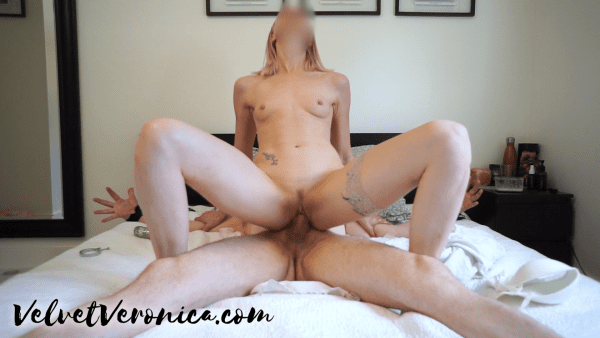 naked woman riding naked man tied to bed in reverse cowgirl position during edging game